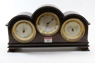 Lot 19 - A burr walnut cased mantel clock, the case of...