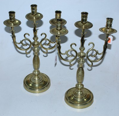 Lot 22 - A pair of turned brass three sconce candelabra,...