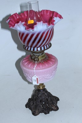 Lot 23 - A Victorian oil lamp, having a frilled...