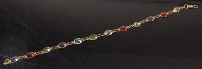 Lot 2598 - A yellow metal multi-stone bracelet,...