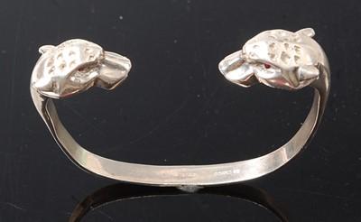 Lot 2599 - A sterling silver leopard head torque bangle,...