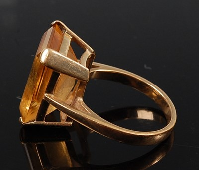 Lot 2578 - A yellow gold citrine single stone ring,...