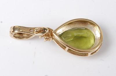 Lot 2588 - A 9ct yellow gold, peridot and diamond pendant,...