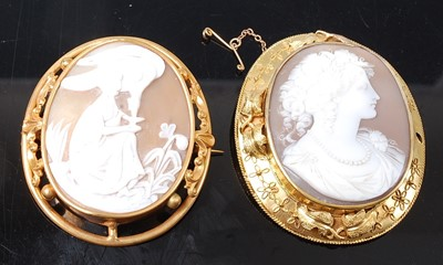 Lot 2592 - Two yellow metal large shell cameo brooches,...