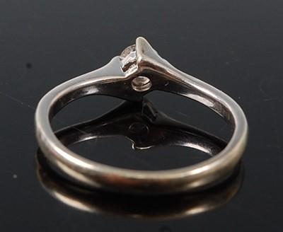 Lot 2594 - A 9ct white gold diamond single stone ring,...