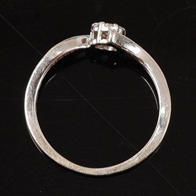 Lot 2595 - A 9ct white gold diamond circular cluster ring,...