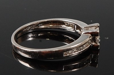 Lot 2596 - A platinum diamond quatrefoil cluster ring,...
