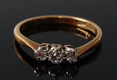 Lot 2602 - A yellow and white metal diamond three stone...