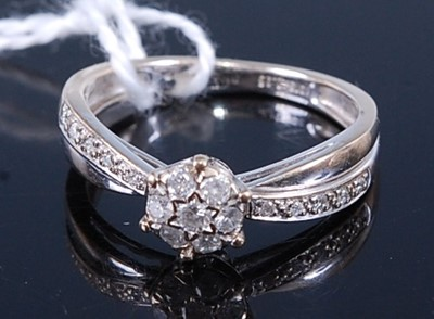 Lot 2605 - A 9ct white gold diamond circular cluster ring,...