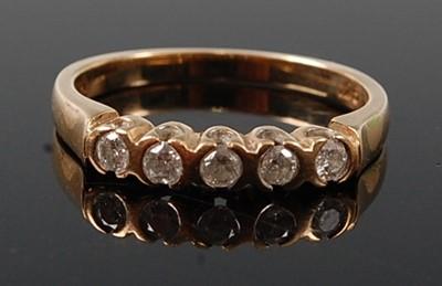 Lot 2606 - A 9ct yellow gold diamond half hoop eternity...