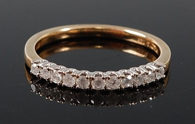 Lot 2607 - A 9ct yellow and white gold diamond half hoop...