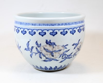 Lot 72 - A Chinese stoneware blue and white jardinière,...
