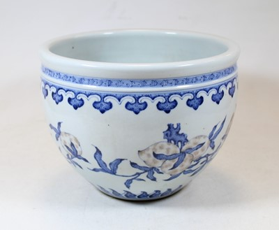 Lot 2 - A Chinese stoneware blue and white jardinière,...