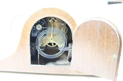 Lot 5 - A 1930s oak cased mantel clock, having a...
