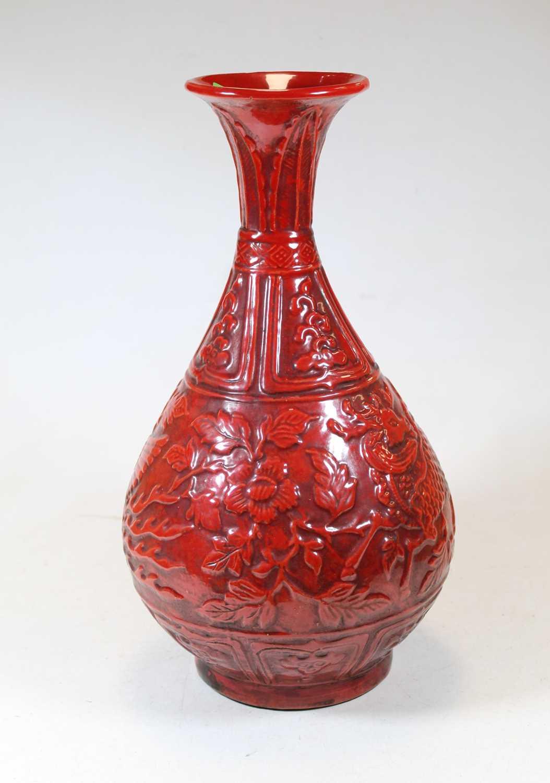 Lot 16 - A modern Chinese red glazed porcelain vase,...