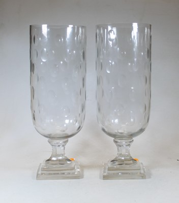 Lot 17 - A pair of modern cut clear glass storm lamps,...