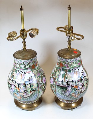 Lot 19 - A pair of Chinese brass mounted table lamps,...