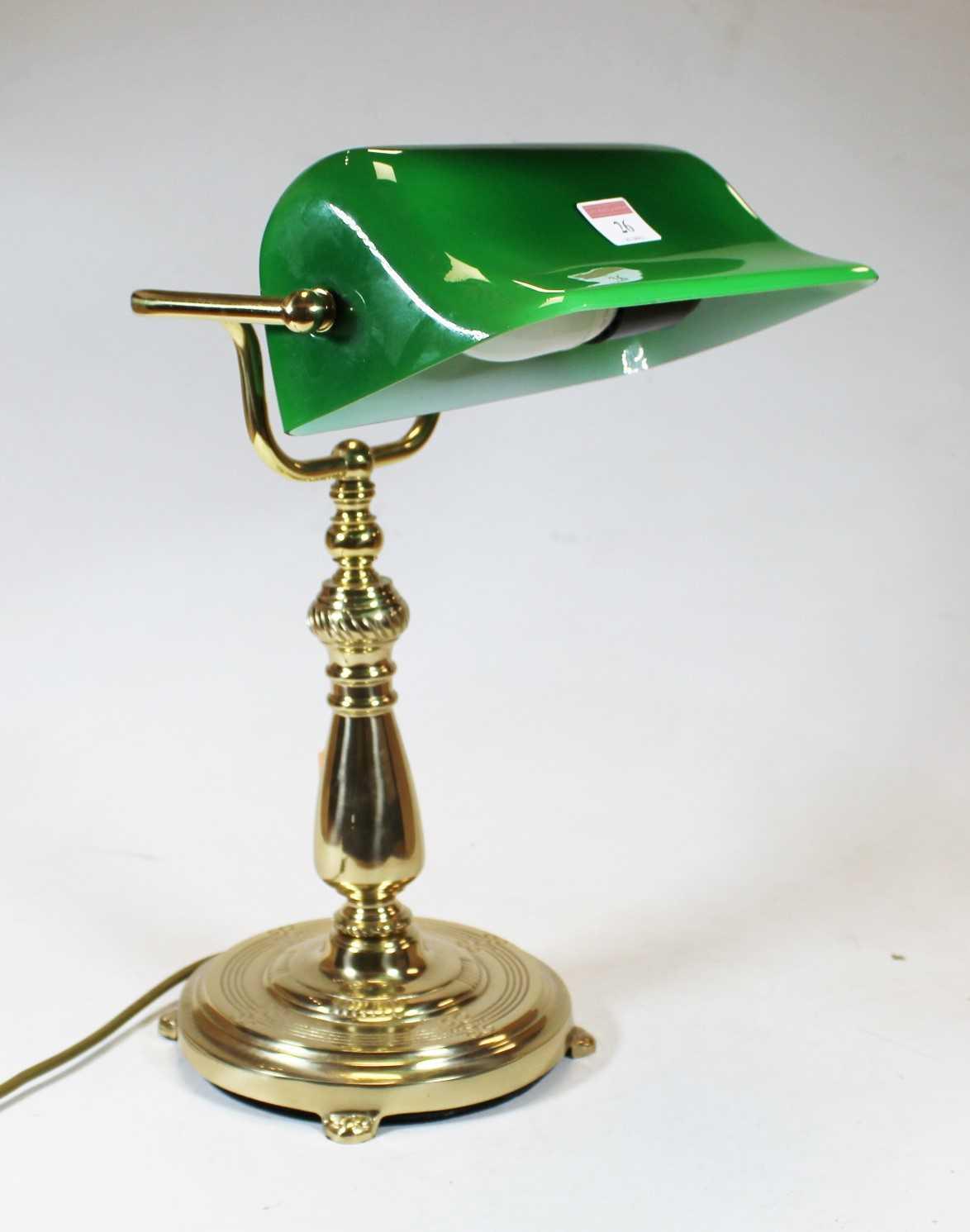 Lot 26 - A modern lacquered brass desk lamp, having an...