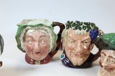 Lot 39 - A collection of three Doulton character jugs,...