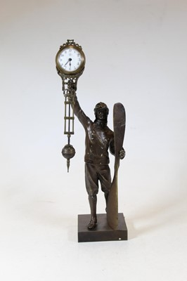 Lot 40 - A modern bronzed mystery clock in the form of...