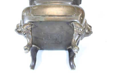 Lot 47 - A Chinese bronze koro, the pierced cover...