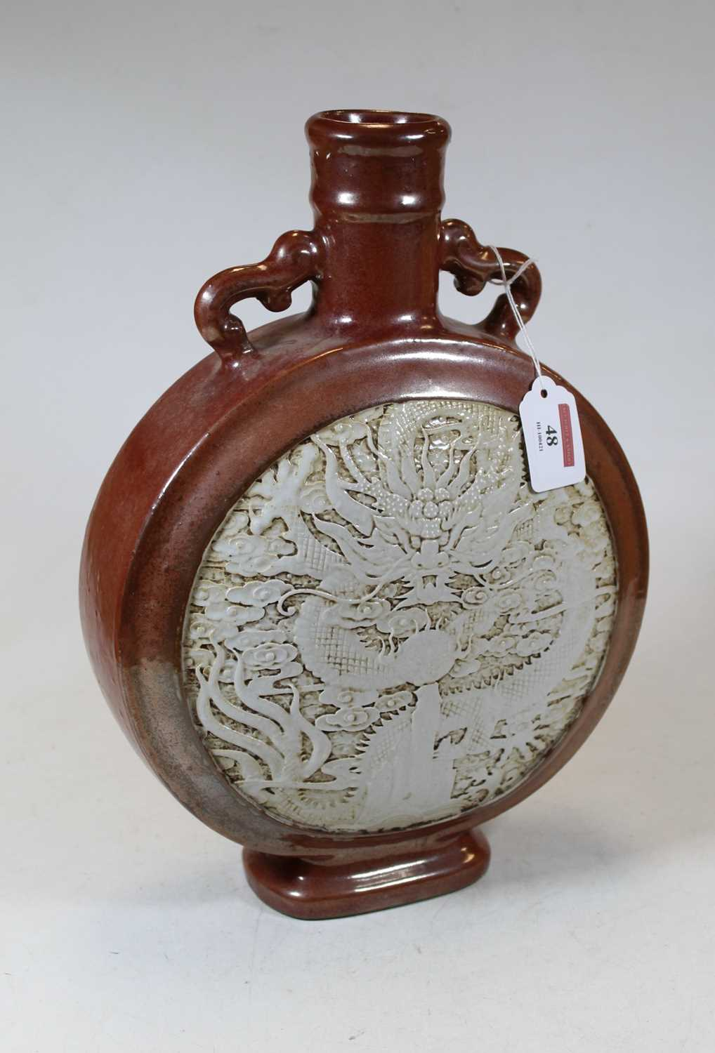 Lot 48 - A Chinese stoneware moon flask, the red lustre...