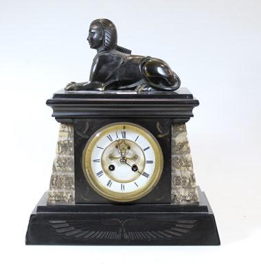 Lot 50 - A late Victorian black slate mantel clock,...