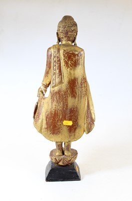 Lot 61 - A carved softwood and gilt painted religious...