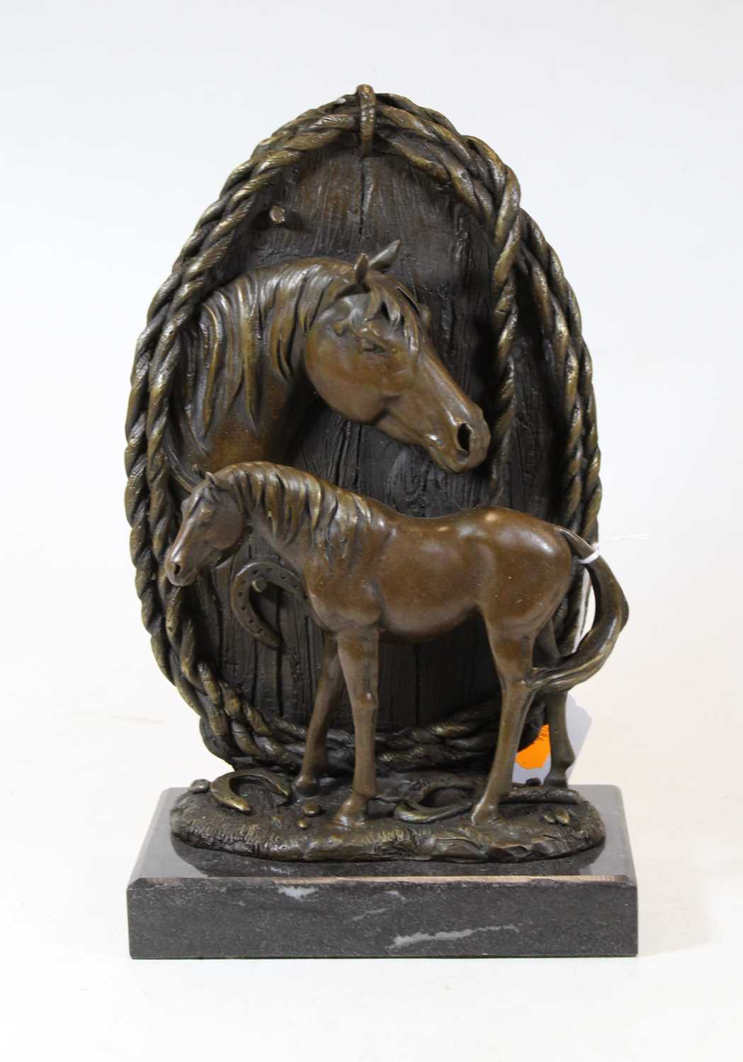 Lot 63 - A modern bronze figure group of a horse and...