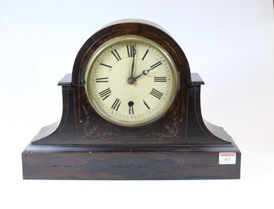 Lot 67 - A late Victorian simulated walnut mantel clock,...