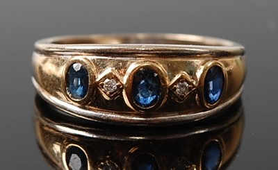 Lot 2612 - A 9ct yellow and white gold, sapphire and...