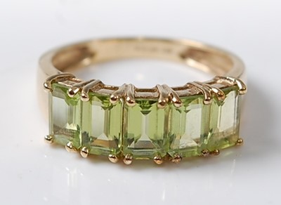 Lot 2619 - A 9ct yellow gold peridot dress ring,...