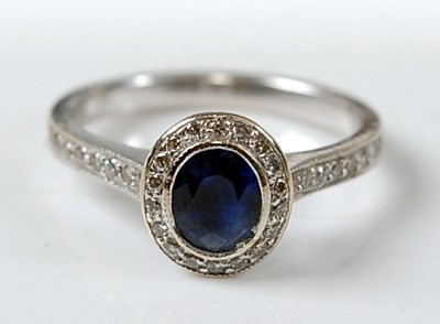Lot 2632 - A white metal, sapphire and diamond oval...