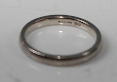 Lot 2633 - A Palladium 2.4mm court shaped wedding band,...
