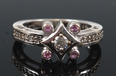 Lot 2634 - An 18ct white gold, diamond and pink sapphire...