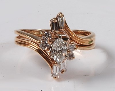 Lot 2635 - A yellow metal diamond marquise shaped cluster...