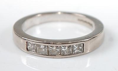 Lot 2636 - An 18ct white gold diamond half hoop eternity...