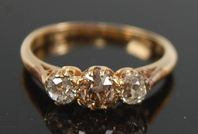 Lot 2637 - A yellow metal diamond three-stone ring,...