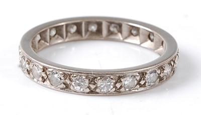 Lot 2674 - A white metal diamond full hoop eternity ring...
