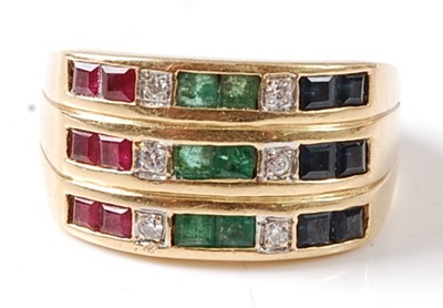 Lot 2675 - A yellow metal ruby, emerald, sapphire and...