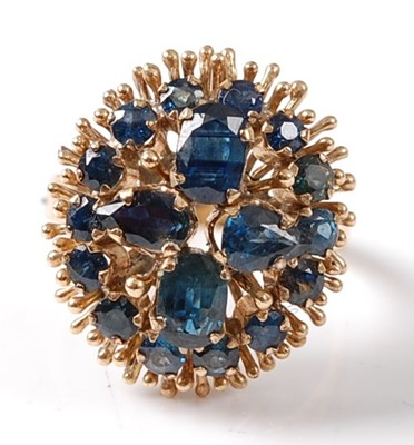 Lot 2665 - A yellow metal sapphire oval cluster ring...
