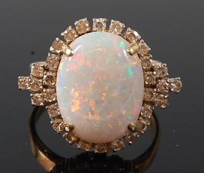 Lot 2666 - A yellow and white metal opal and diamond oval...