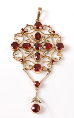 Lot 2667 - A yellow metal Edwardian garnet and seed pearl...