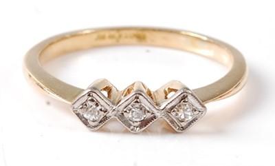 Lot 2676 - A yellow and white metal diamond three stone...