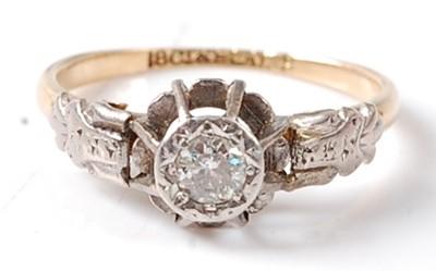 Lot 2677 - A yellow and white metal diamond single stone...