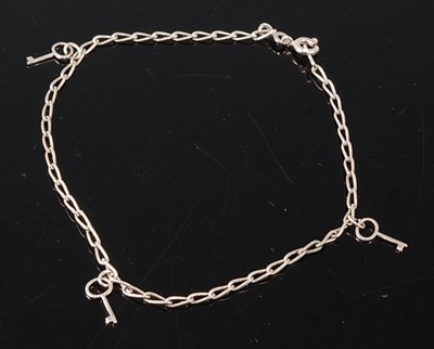 Lot 2679 - A white metal elongated curb link anklet with...