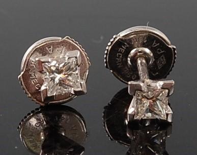 Lot 2680 - A pair of white metal diamond single stone...