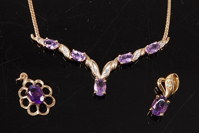 Lot 2681 - A suite of amethyst jewellery comprising the...