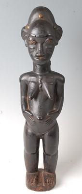 Lot A female ancestor figure, Baule People, Ivory...