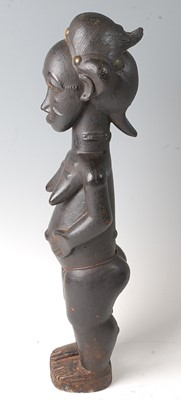 Lot 212 - * A female ancestor figure, with libations of...